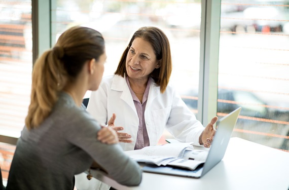 Physician consulting with patient