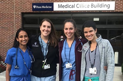 Women in medicine residents in front of building