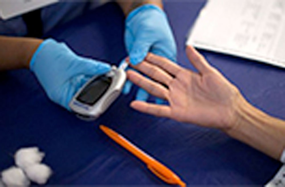 Patient getting tested for blood sugar