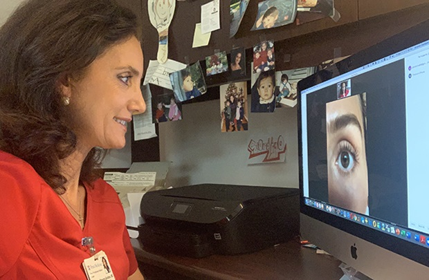Dr. Mina Massaro with a patient over telemedicine