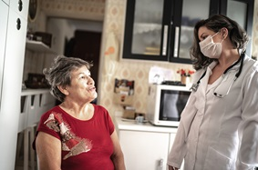 Cancer Care at Home Program  image showing patient and certified home infusion nurse