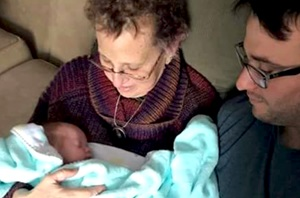 Lung cancer patient, Kim, holding her grandson for the first time