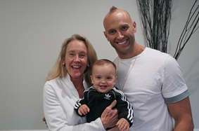Mark Herzlich with his mother, Barb Herzlich, and son Boston Herzlich