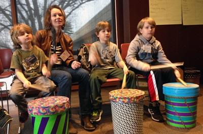 Mother and three sons at The Power of Drumming Grief Reach Program event