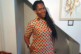 Angela Banks-Konate poses of a photo after bariatric surgery