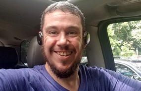 Shawn W taking selfie in car after bariatric surgery