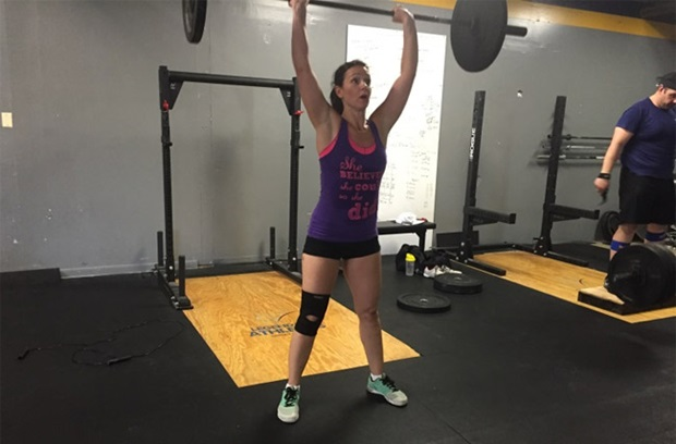 Photo of Rachelle lifting weights