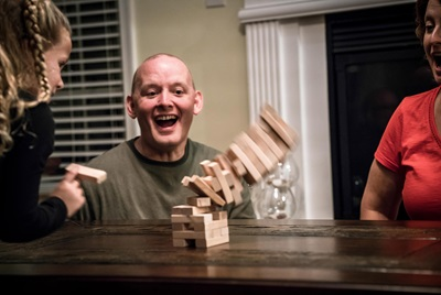 Dan Bonner, liver transplant recipient, playing Jenga with family