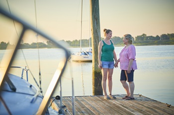Living liver donor transplant - daughter Sarah and mother Kathy holding hands on dock