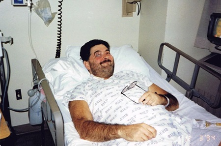 Mike's Before Surgery photo, lying in hospital bed