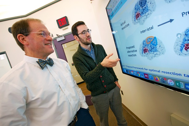 Brian Litt, MD, pictured with John Bernabei, MD, PhD, (right), is exploring the use of virtual cortical resection as a means of guiding epilepsy surgery.