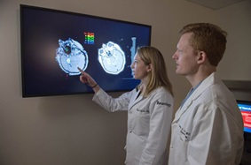Dr. Davis and colleague review imaging