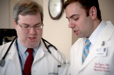 Dr. Negoianu and Dr. Goldberg discussing a case