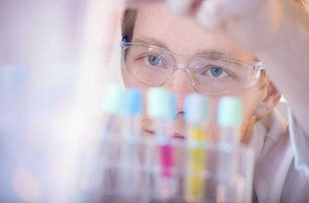 Scientist staring at vials