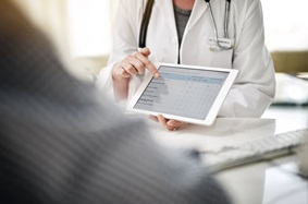 Doctor showing patient digital survey