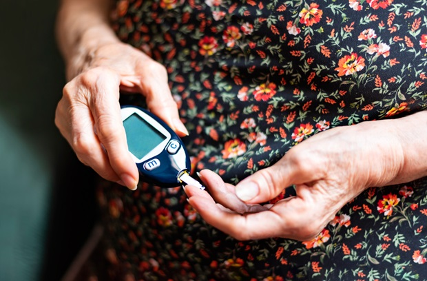 Older woman tracking her blood glucose levels