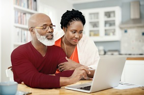 Mature couple looking at computer together