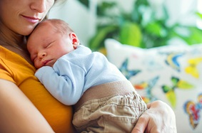 Mom holding newborn son