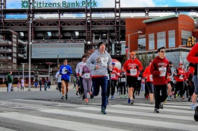 People running in a 5k outside Citizens Bank Park
