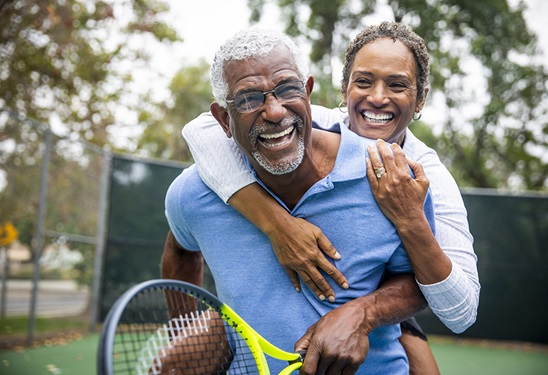 Older Man and Woman Tennis Laughing