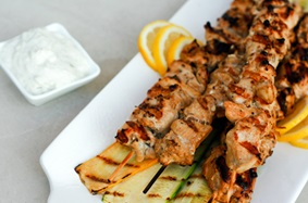 Grilled chicken souvlaki skewers with with tzatziki sauce