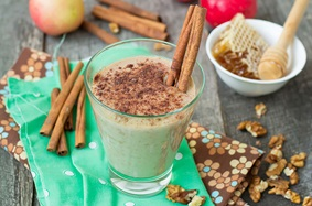 Milkshake with cinnamon and cinnamon sticks