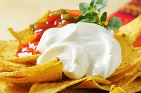 Healthy nachos with sour cream