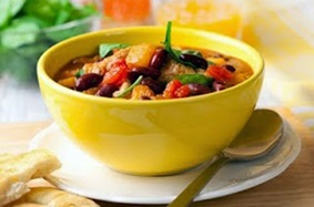 Yellow bowl filled with vegetables and meat