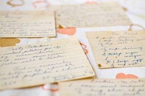 Scattered handwritten recipe cards