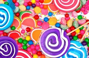 Colorful lollipops, gumballs, gummies, rock candy, sprinkles, and more