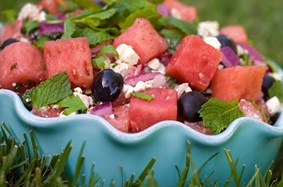 Sweet and light watermelon salad with mint, onions, olives and crumbled feta cheese