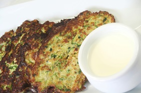 Zucchini and potato pancakes with tzatziki
