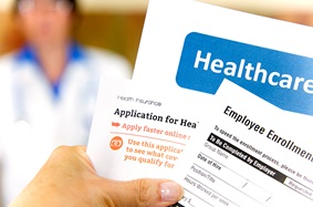 Close-up view of health insurance benefit application forms