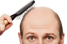 balding man brushing hair