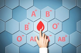 blue_background_hexagons_with_blood_types_and_one_drop_of_blood_hand_clicking_on_blood_drop