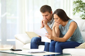 a man and woman stressing over finances