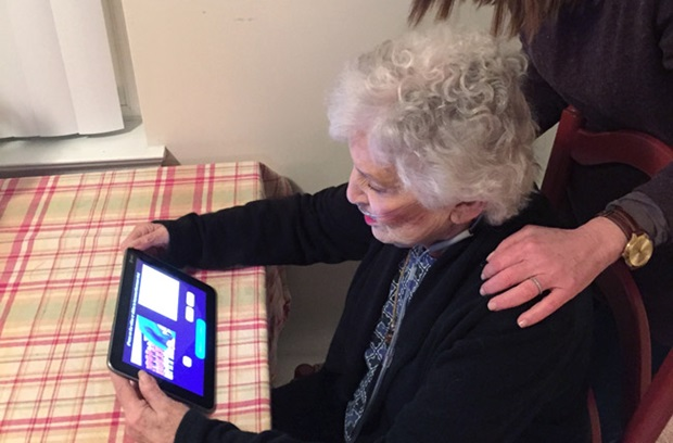 Elderly home health patient using Telehealth tablet