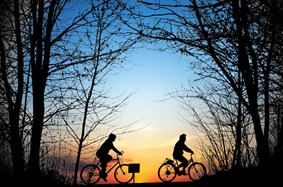 Friends cycling at sunset