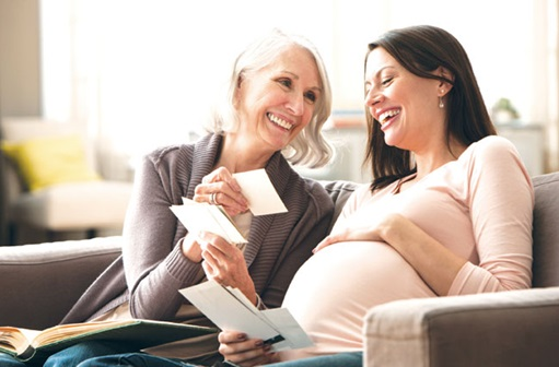 Pregnant woman laughing with her mother