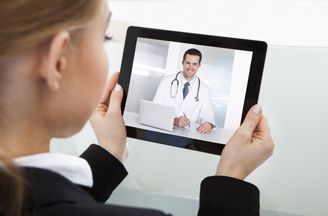 Person viewing a physician video on a tablet