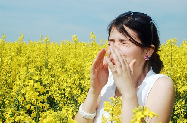 Woman with allergies in a field
