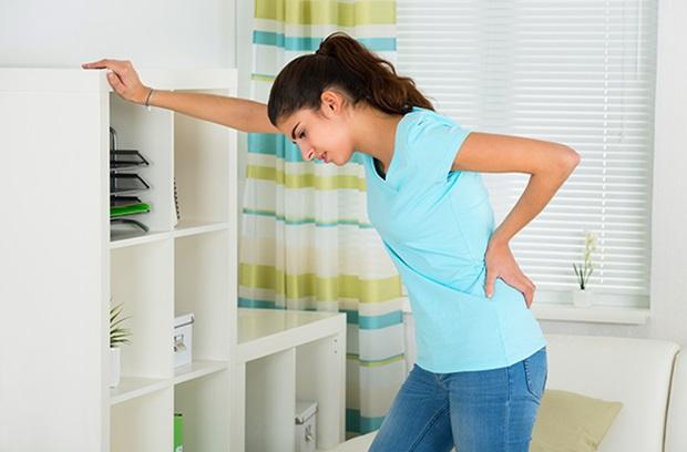 Women Holding Lower Back