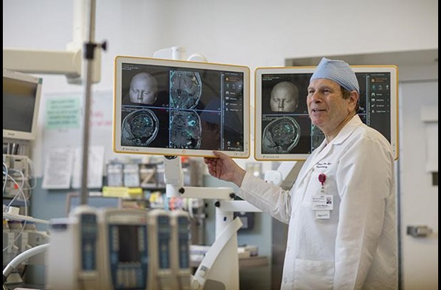Brain Tumor Center-Dr. Steven Brem Looking at Brain Tumor Scans