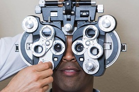 close-up of man getting an eye exam