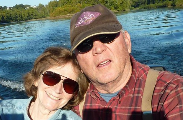 Joseph back pain spine patient on boat with wife