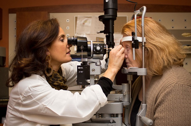 Physician performing eye exam