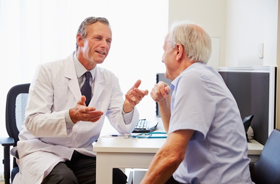 image of male doctor talking to male patient