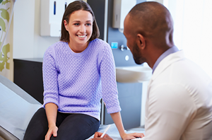 woman meets with her doctor for appointment