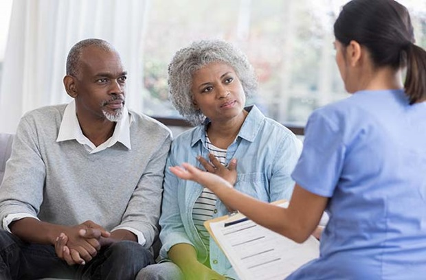 Older couple talking to provider