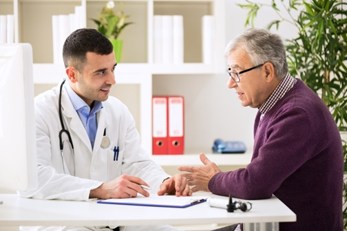 Older man talking to doctor about treatment options